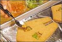 в окошки насыпьте разноцветную леденцовую крошку и снова поставьте в духовку до расплавления леденцов, примерно на 2 минуты