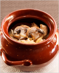 meat with mushrooms in a pot