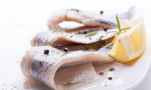 Salted herring with lemon