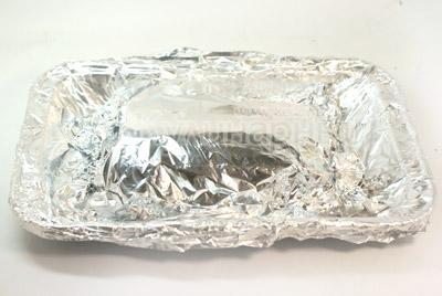 Завернуть в фольгу и запечь в духовке 25-30 минут при температуре 200 градусов С. - Слоёная рыбка. Фото приготовления рецепта.