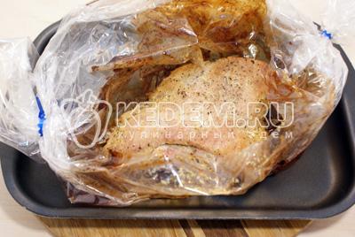 Выложить пакет с мясом на противень и запекать в духовке при 200 градусах С 30-35 минут